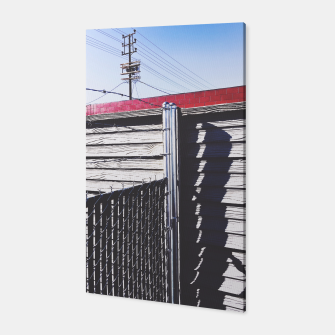 Thumbnail image of steel fence and wooden fence with red building and blue sky background in the city Canvas, Live Heroes