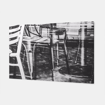 outdoor chairs in the city in black and white Canvas thumbnail image