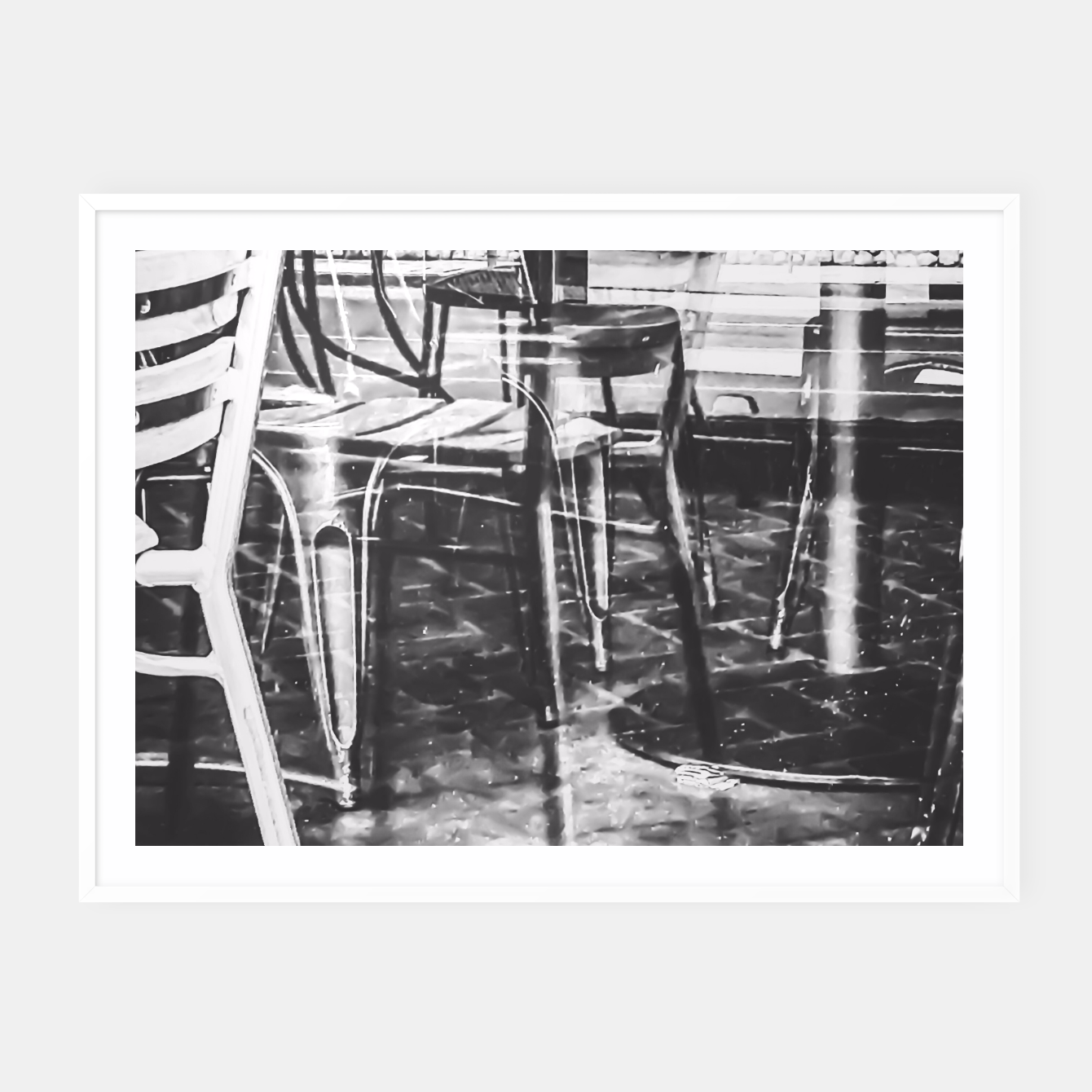 Image of outdoor chairs in the city in black and white Framed poster - Live Heroes