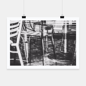 outdoor chairs in the city in black and white Poster thumbnail image