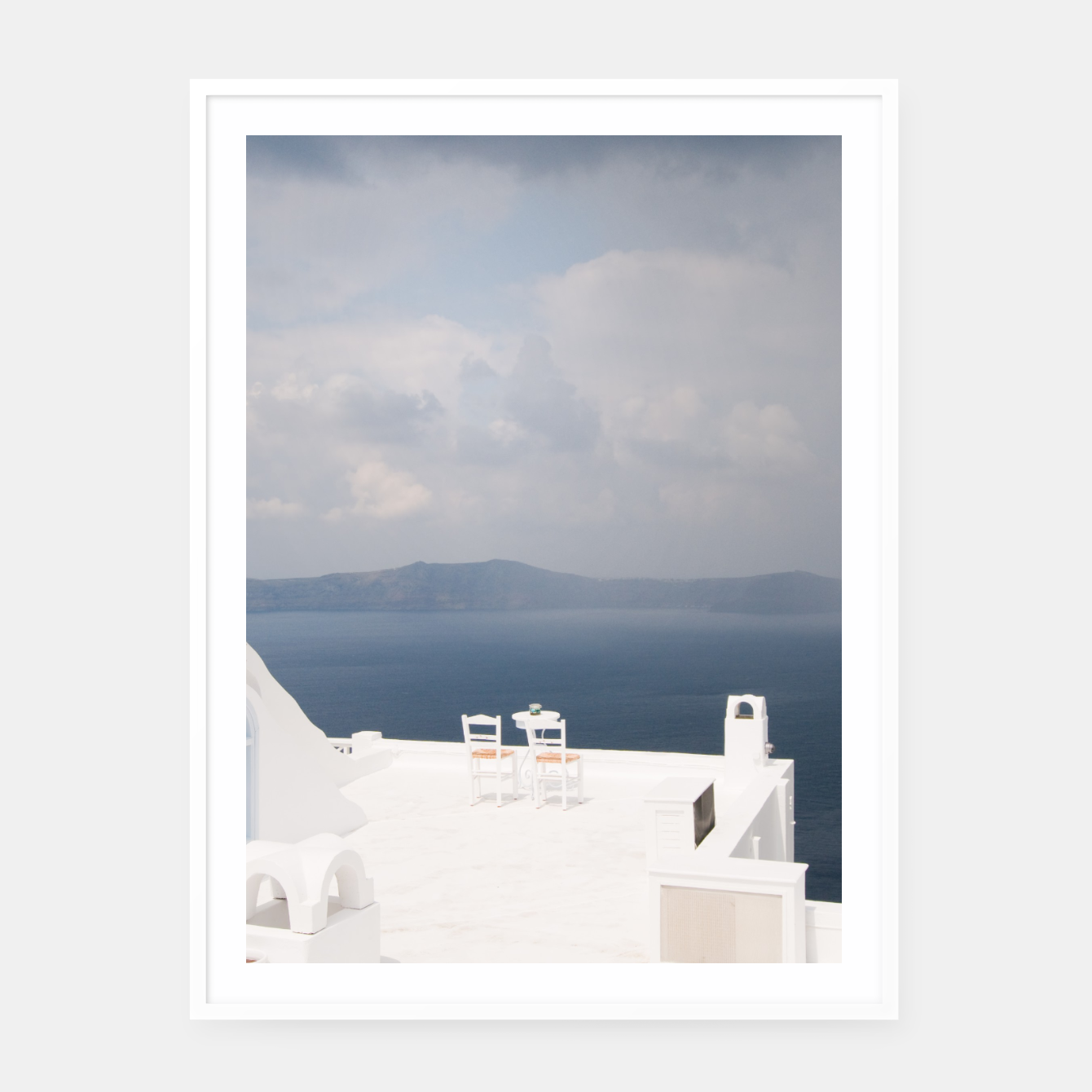 Image of Two chairs on Santorini island Framed poster - Live Heroes