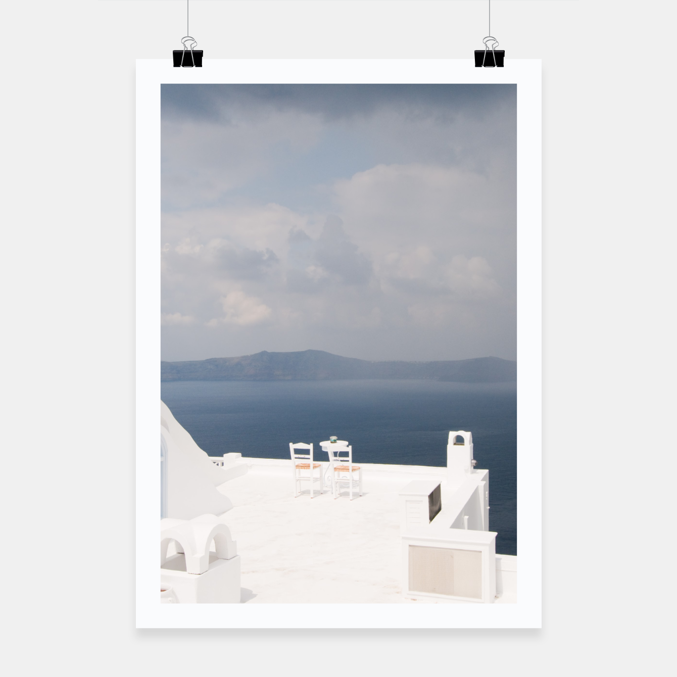 Image of Two chairs on Santorini island Poster - Live Heroes