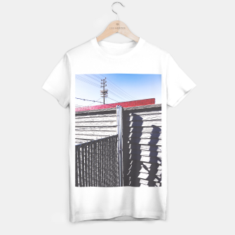 Thumbnail image of steel fence and wooden fence with red building and blue sky background in the city T-shirt regular, Live Heroes