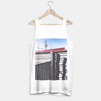 Thumbnail image of steel fence and wooden fence with red building and blue sky background in the city Tank Top regular, Live Heroes