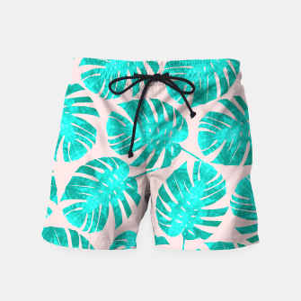 Thumbnail image of Green tropical leaves on pink background Swim Shorts, Live Heroes