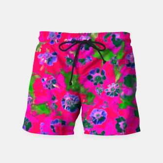 Thumbnail image of blooming pink flower with green leaf background Swim Shorts, Live Heroes