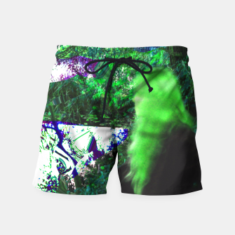 Thumbnail image of Walking by in greenhair Swim Shorts, Live Heroes