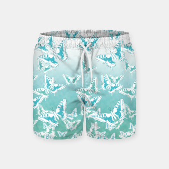 Miniatur blue butterflies in the sky Swim Shorts, Live Heroes