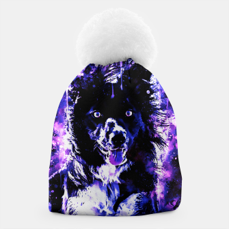 Thumbnail image of border collie dog lying down watercolor splatters cool blue purple Beanie, Live Heroes