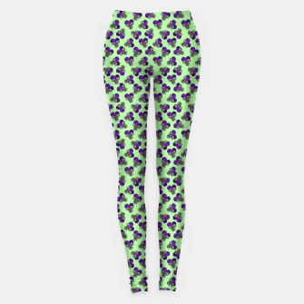 Flowers violets on a green background Leggings thumbnail image