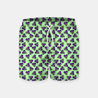 Flowers violets on a green background Swim Shorts thumbnail image