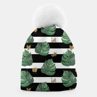Thumbnail image of Seamless tropical leaves pattern on stripes background. Greens leaves of exotic monstera plant. Retro style illustration. Beanie, Live Heroes