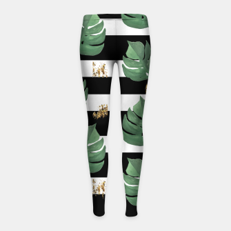 Thumbnail image of Seamless tropical leaves pattern on stripes background. Greens leaves of exotic monstera plant. Retro style illustration. Girl's leggings, Live Heroes
