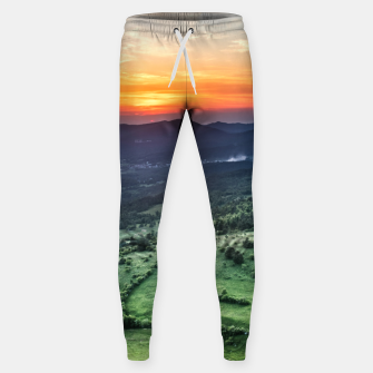 Thumbnail image of Beautiful sunset behind green fields Sweatpants, Live Heroes
