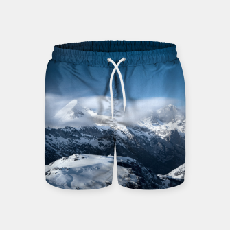 Thumbnail image of Clouds rolling above snowy mountains Swim Shorts, Live Heroes