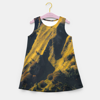 Grass covered mountain in autumn Girl's summer dress thumbnail image