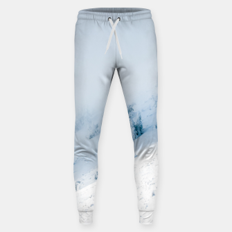 Frozen trees sun and clouds in the mountains Sweatpants miniature