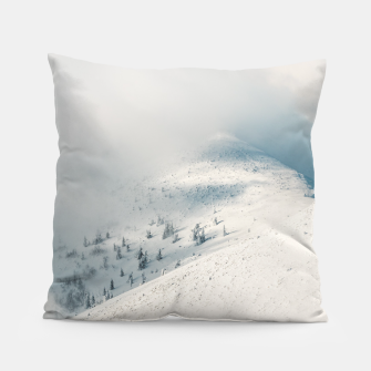Thumbnail image of Clouds clearing above spruce forest and snowy mountains Pillow, Live Heroes