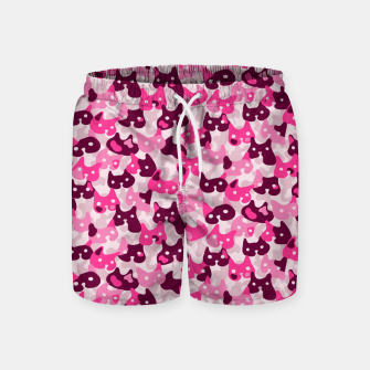 Thumbnail image of Ghostly camouflaging cats are watching you in pink Swim Shorts, Live Heroes