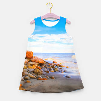 Miniatur sandy beach with blue cloudy sky in summer Girl's summer dress, Live Heroes