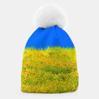 Miniatur yellow poppy flower field with green leaf and clear blue sky Beanie, Live Heroes