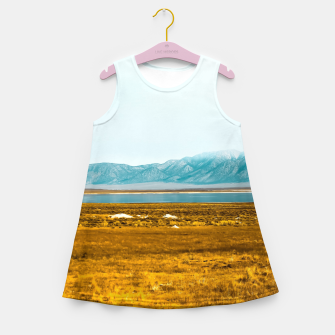 Thumbnail image of dry grass field and mountains background in California Girl's summer dress, Live Heroes