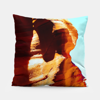 Thumbnail image of Orange sandstone abstract with blue sky at Antelope Canyon, Arizona, USA Pillow, Live Heroes