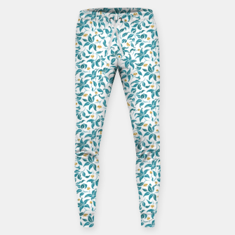 Thumbnail image of The wall of orange buds and blossoms in white Sweatpants, Live Heroes