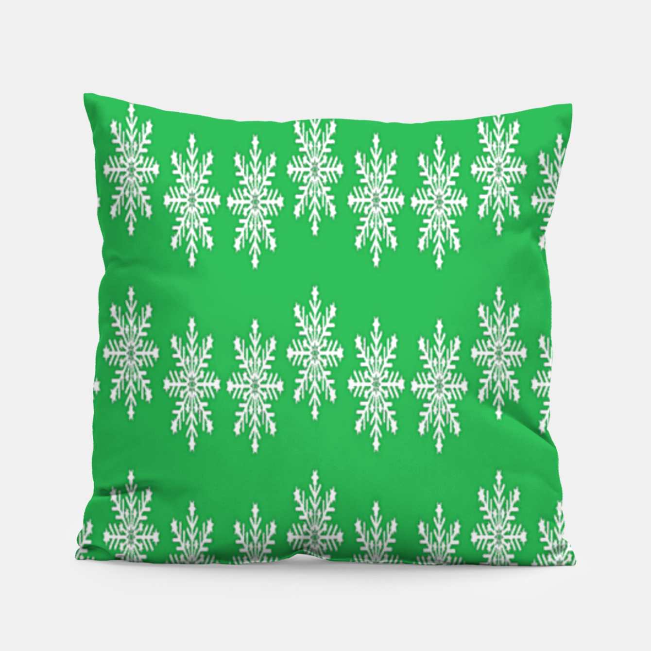 Image of White snowflakes on green Pillow - Live Heroes